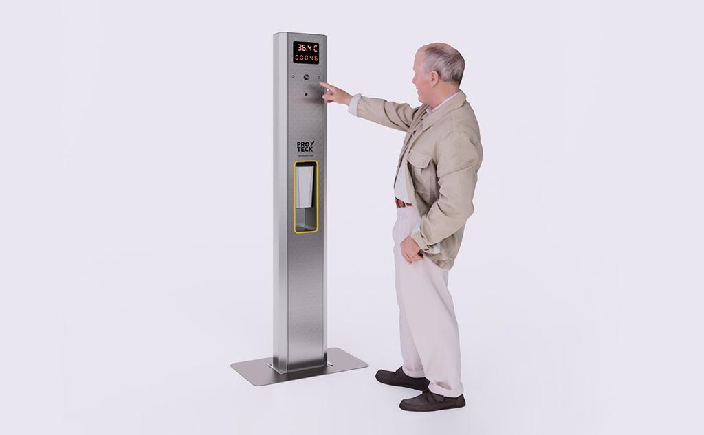 Hombre utilizando máquina de medición de temperatura y desinfección